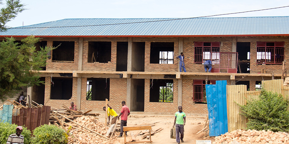 Constructing new classrooms at Gikomero.